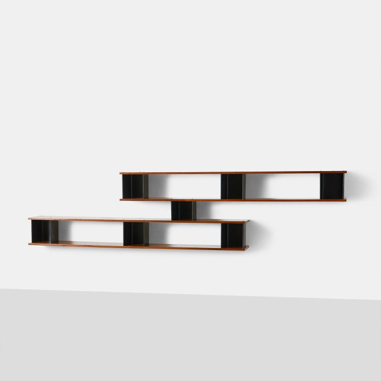 """""""Nuage"""" wall shelf by Charlotte Perriand Ash-veneered plywood, painted steel, aluminum. Metal produced by Métal Meubles and wood produced by Négroni, France, circa 1956."""