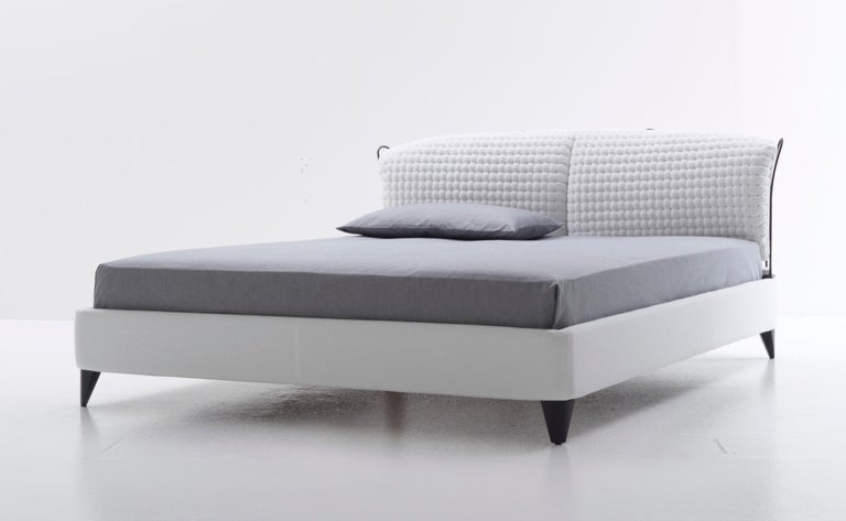 Wooden footboard covered by polyurethane foam. Curved steel headboard frame painted under high heat with cushions padding in shape retaining polyurethane foam. Available also version without metal frame at sight, but only with headboard cushions.