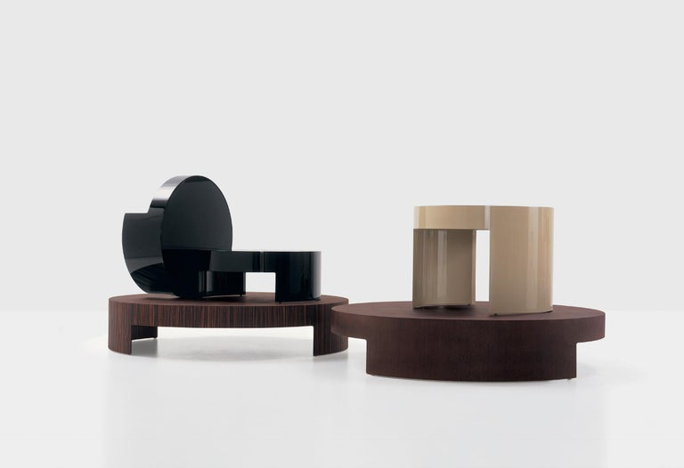 Curved multi-layered wood. Finishing available: mat or polished lacquered or veneered wood zebrano, wengé, beech wood.  Carlo Colombo is considered one of the most important Italian architects and designers. He started his career right away with