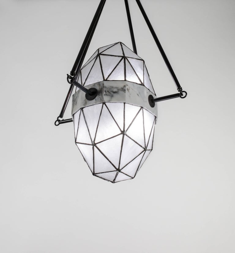 """Nucleus is a large scale pendant in Carrara marble and glass made to order by Kalin Asenov studio.   Dimensions: L 30"""", H variable"""" W 18"""".  Materials: glass Carrara marble patinated brass.  The listing is for ice finish. Available also in"""