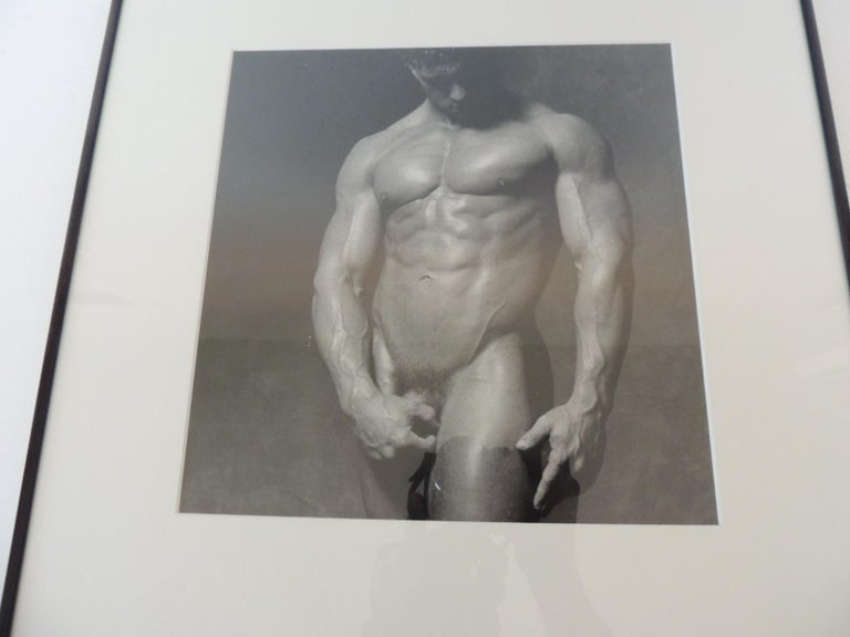 Nude black and white abstract photograph of muscular male standing flexing. Black metal frame and museum quality white mat. (glass) Found in New York City. Size of photo: 10