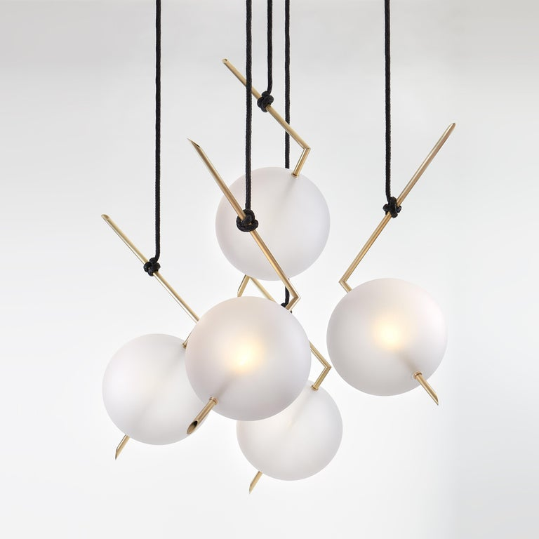 Nuvola Five Lights Chandelier - Stardust-White Pendant lamp floats in space like a bright jewel hanging from the ceiling, hooked at the end of a leather cord that has been hand-knotted around the brass tube; a perfect equilibrium of different