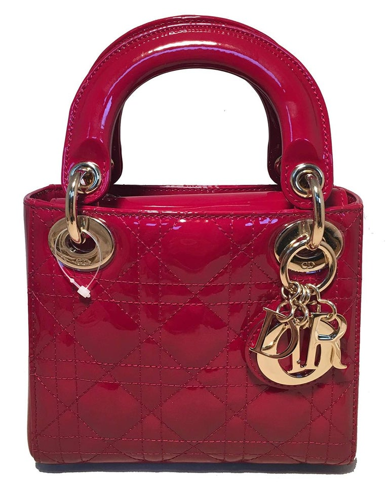 NWOT Christian Dior Red Patent Leather Mini Lady Dior Bag in like-new condition. Red patent leather cannage quilted exterior trimmed with gold hardware. Removable matching gold chain shoulder strap and leather strip at shoulder for added comfort and
