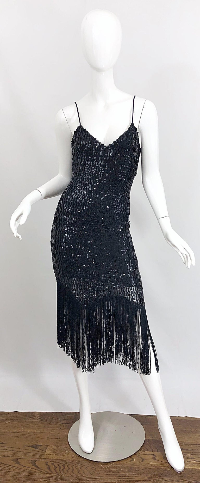 New with tags 70s does 20s JOY STEVENS black sequined flapper style fringed dress! Features thousands of hand-sewn black sequins throughout. Fringe hem makes this dress perfect for dancing. Figure flattering fit that features some stretch. Hidden