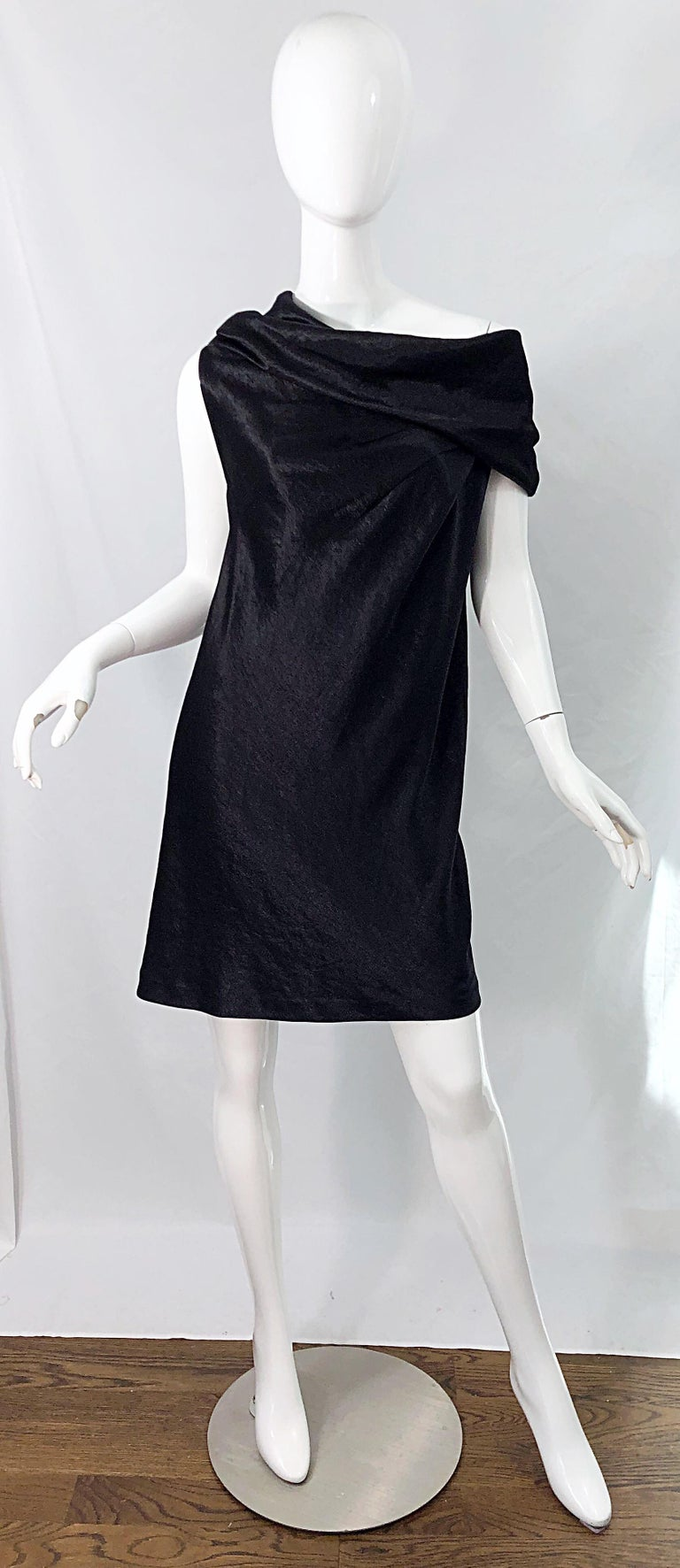 Chic brand new with original store tags late 90s DONNA KARAN black metallic rayon off-shoulder dress ! Features a soft luxurious textured metallic rayon - the tag describes it as a metallic satin textured rayon. This beauty simply slips over the