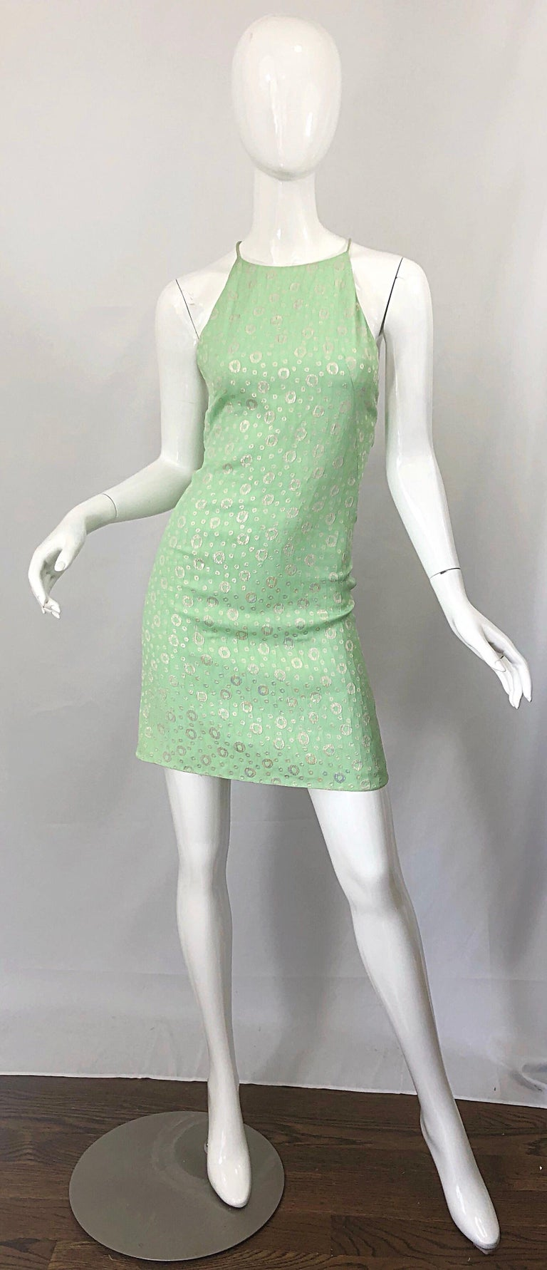 Chic brand new with tags ( NWT ) JAMES PURCELL couture quality silk sherbert mint green and gold silk racer back mini dress! Features a luxurious silk, with plastic pvc covered clear racerback straps. Hidden zipper up the back with hook-and-eye
