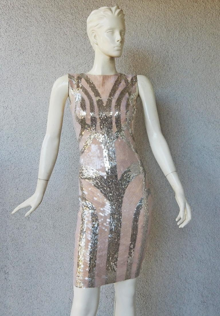 Alexander Mcqueen 2009 hand beaded evening dress. Form fitting and tastefully fashioned of nude silk showered with clear sequins overlaid in a geometric pattern of silver sequins. Boasts an interior corset creating a streamline silhouette. In