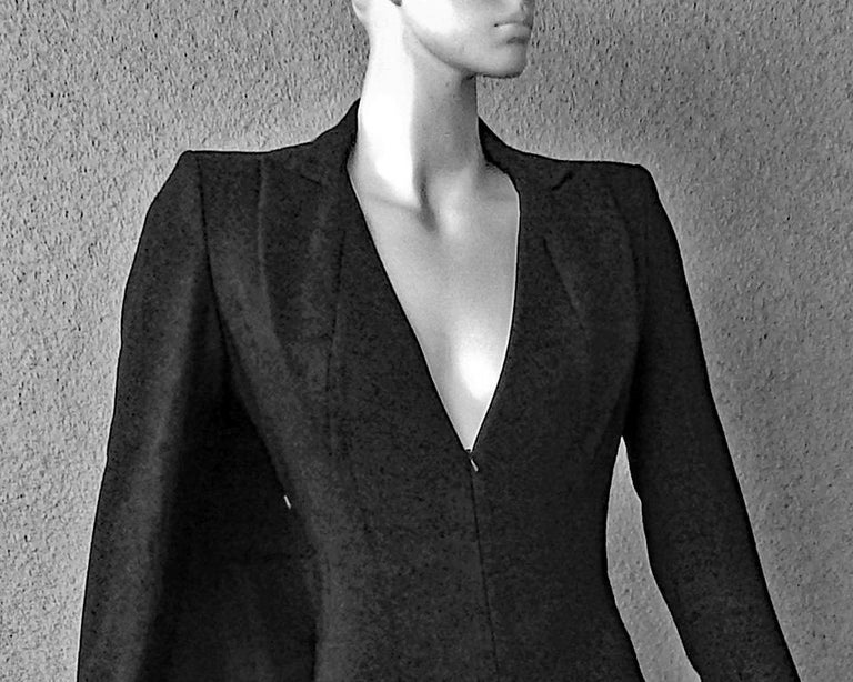 """In this 2013 """"Finale Tuxedo Jumpsuit with Train"""" is a design inspired by the tabard cady gown which is a signature silhouette that Antonio Berardi does remarkably well.     Jumpsuit fashioned as a tuxedo inspired creation with attached long wide"""