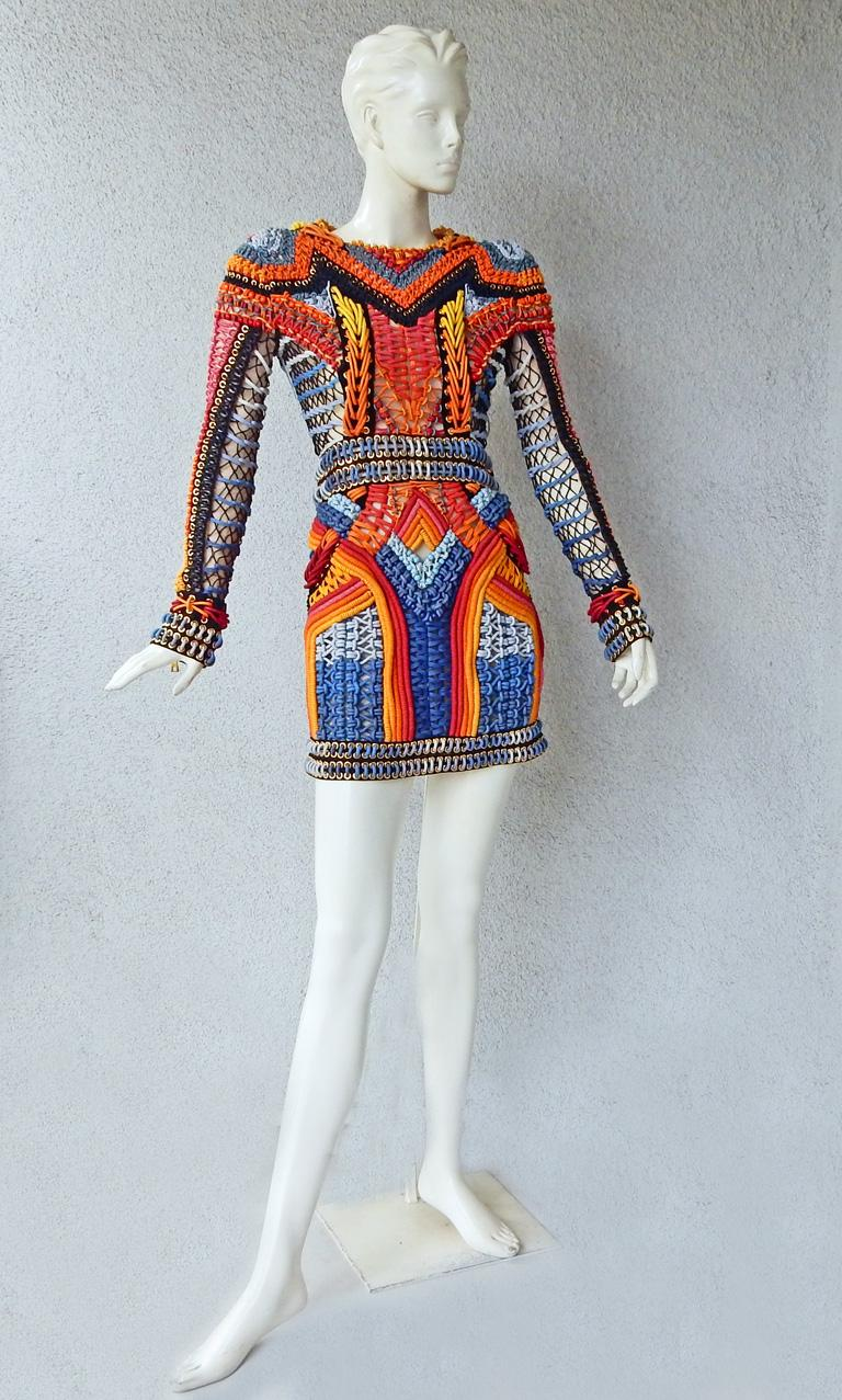 Balmain colorful crochet and macramé dress bordered with gold chain.   Fabulous multi-hued crocheting!   Special Aztec-inspired artisan hand made garment with graphic weave of colored beaded bands in both crochet and macrame.  Also features zipper