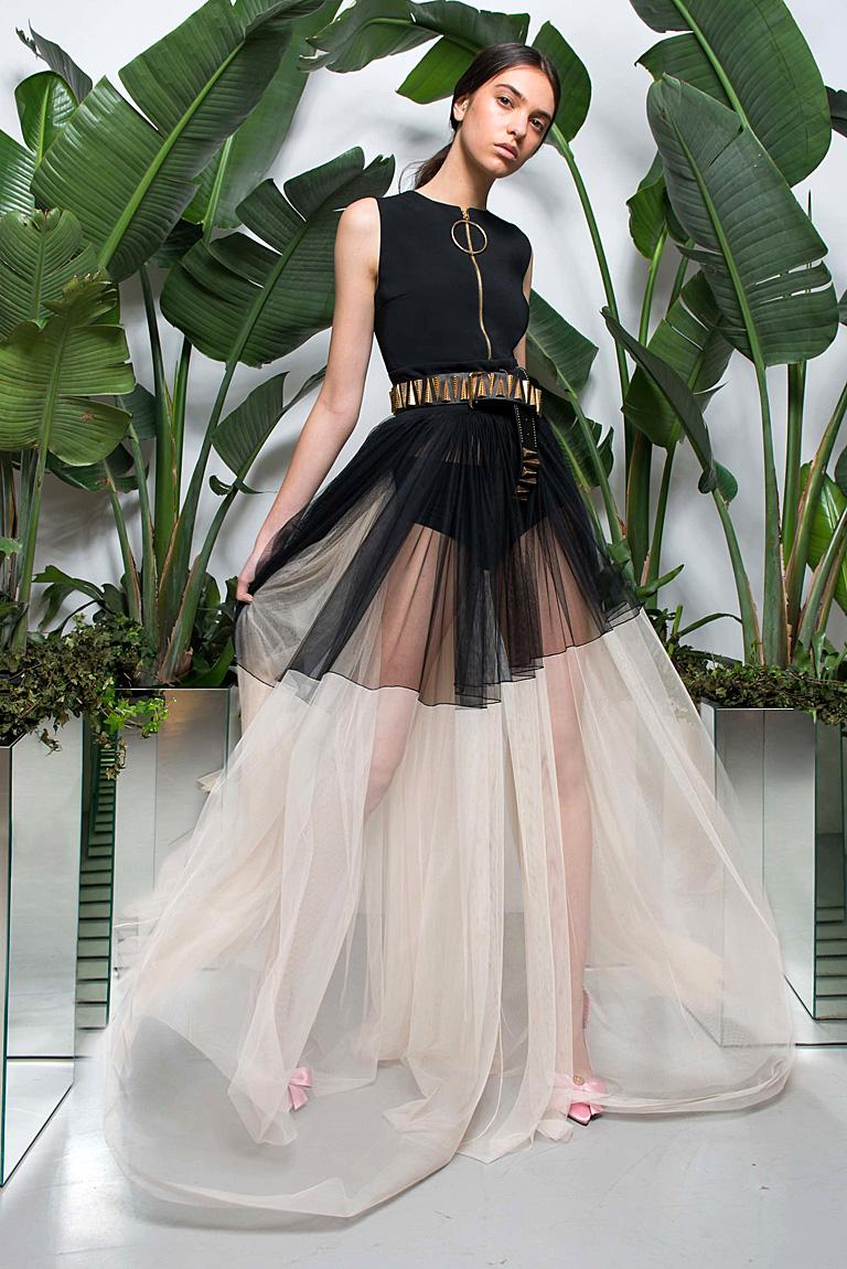 Fabulous black and off white asymmetric runway gown by Fausto Puglisi.  Eye catching presence showcases a fabulous feast for the eyes.     Fashioned of black crepe and ecru net with separate slip to be worn with or without.  (see photos)  Features