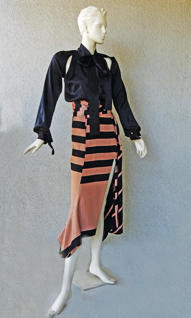 Juan Carlos Obando two-tone striped silk dress.   Fashioned of black and blush shades in hammered silk fabric.    Bodice of black silk charmeuse.  Features bias cut skirt with tie open neck; open shoulder sleeves; and tie wrists.  Dramatic open