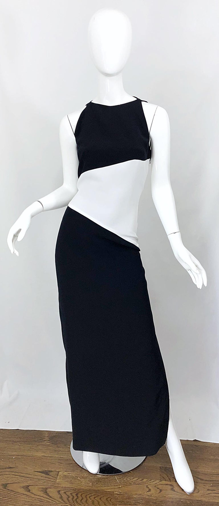 Beautiful and flattering brand new with original store tags vintage BOB MACKIE black and white color block Size 8 evening gown! Features blak crepe at bust, white crepe at waist, and black crepe skirt. High neck with a slit at the left leg that