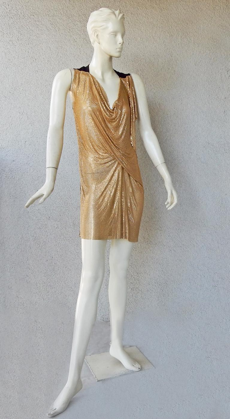 Vionnet gold chain mail mini dress.   Designed with asymmetric draping and jersey black back. Fashioned with subtle raw edge adornment around the dress.   As seen on Amal Clooney (see photo).   Easy to wear and just slips over the body.  Size: 40;