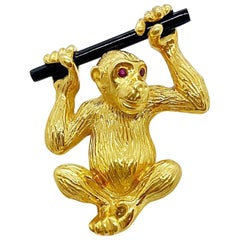 NYC 18 Karat Yellow Gold Monkey Brooch with Onyx and Ruby