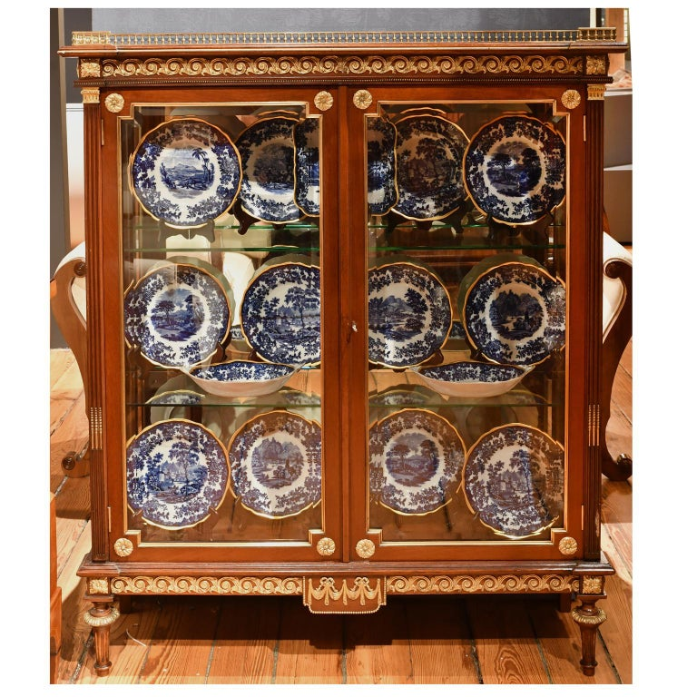 From the Gilded Age, a very beautiful New York City vitrine in the Louis XVI style, attributable to Leon Marcotte, in mahogany with Fine brass ormolu mounts and gallery, beveled glass on front and side panels, and two adjustable glass shelves, circa