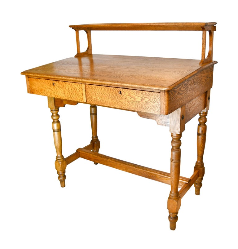 This gorgeous standing desk is made of lovely oak and features two large drawers. The richness of the wood grain on this desk needs to be seen to believe!