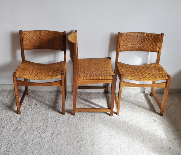 Set of three dining chairs model 351 designed by Peter Hvidt & Orla Mølgaard-Nielsen made of solid oak, woven cane seat and backpiece. Original cane in a good condition. Manufactured by Søborg Møbler, 1959. Patinated with signs of wear consistent
