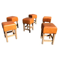 Oak and Cognac Saddle Leather Stools or Chairs in the Style of Jean-Michel Frank