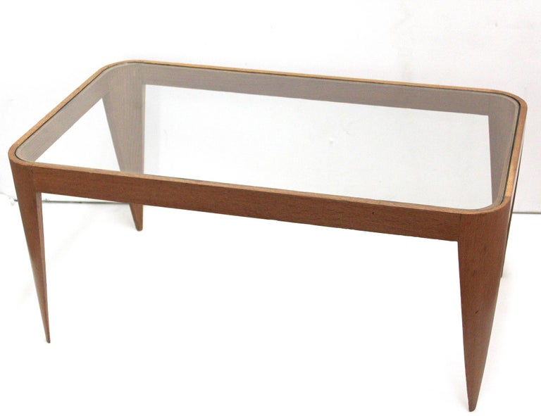 Italian stiletto-legged oak and glass coffee table, designed in 1940 by Gio Ponti. Its delicate, lightweight structure was an early study in the ideas used to great effect in his iconic 1957 Superleggera chair for Cassina.