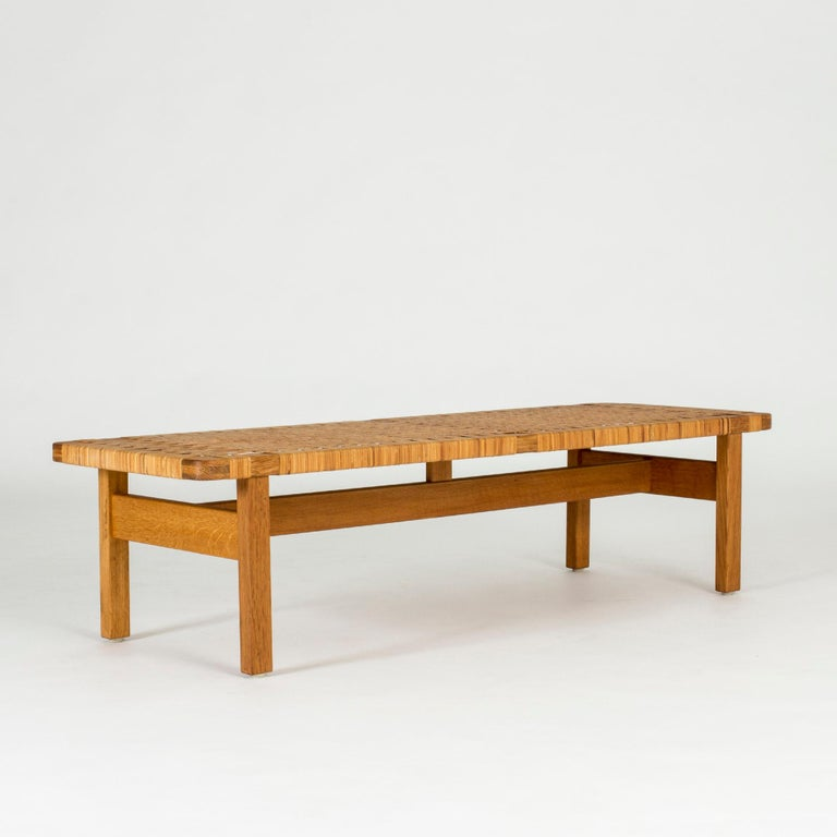 Beautiful oak and rattan bench by Børge Mogensen. Amazing materials, low design that works both as a bench and a coffee table.