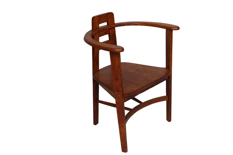 Interestingly bold armchair reminiscent of designs by Charles Rennie Macintosh This later Iteration Exhibits the same Distinctive Profile.