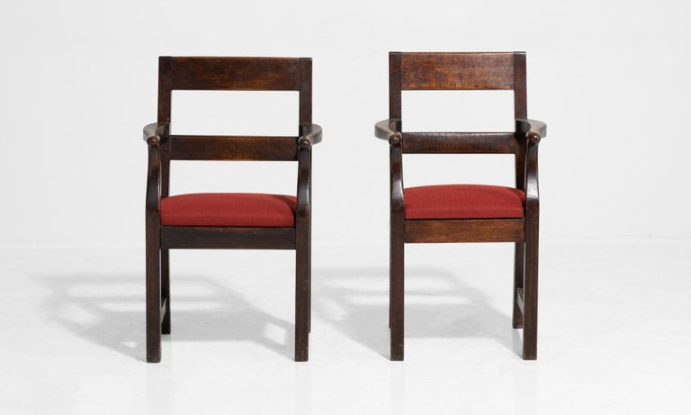 Near pair of handsome oak chairs with newly upholstered seat.