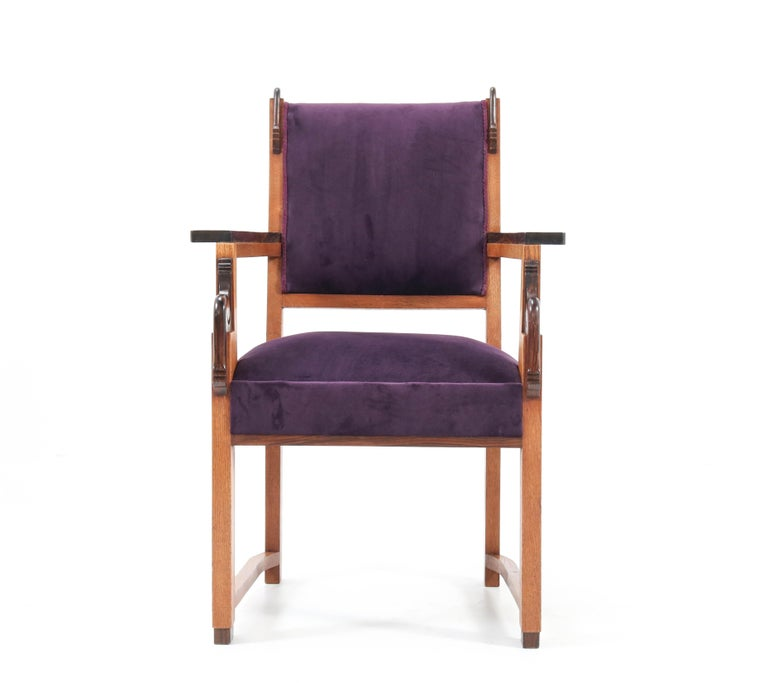Magnificent and rare Art Deco Amsterdam School armchair. Design by H.W. Tolenaar Rotterdam. Striking Dutch design from the 1920s. Solid oak with solid ebony Macassar armrests and details. This wonderful piece of furniture is re-upholstered with