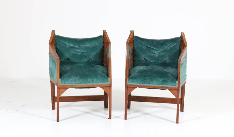 Stunning and rare pair of Art Deco Amsterdam School armchairs. Design attributed to H. van Dorp. Striking Dutch design from the 1920s. Solid oak with green emerald upholstery. In good original condition with minor wear consistent with age and