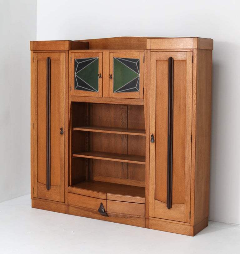 Dutch Oak Art Deco Amsterdam School Bookcase with Stained Glass, 1920s For Sale