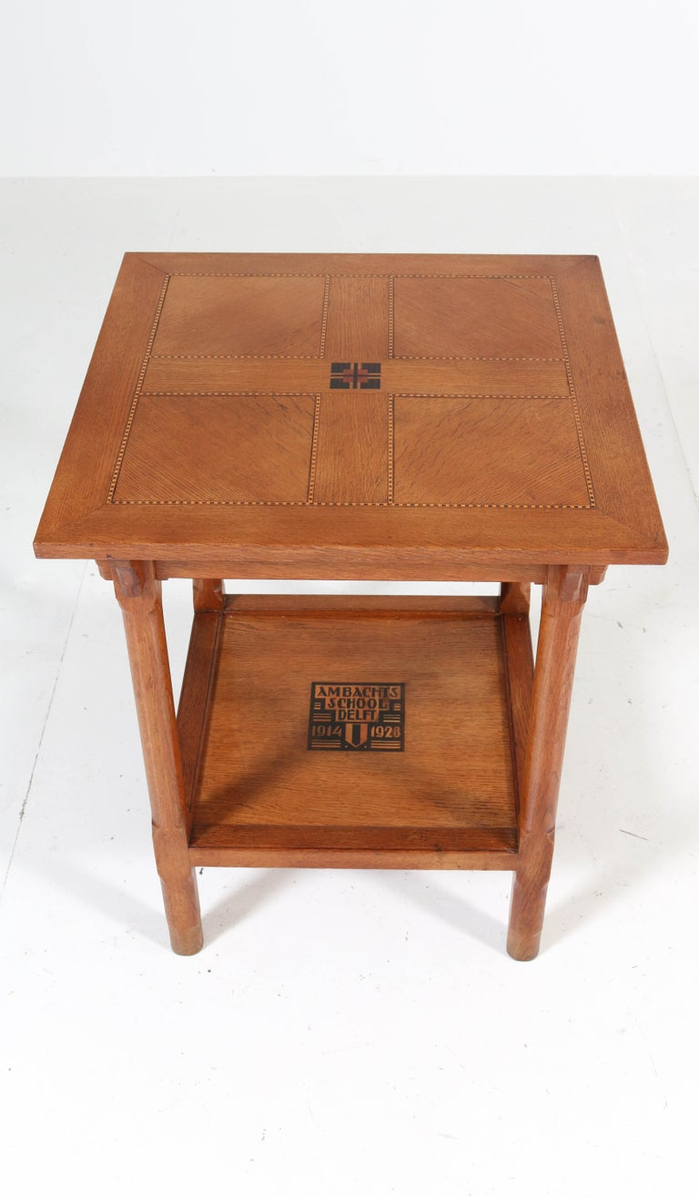 Stunning and rare Art Deco Amsterdam School coffee table. This table has been executed by pupils of the Ambachts School delft in 1928. Solid oak with inlay and description Ambachts School delft 1914-1928. In very good original condition with