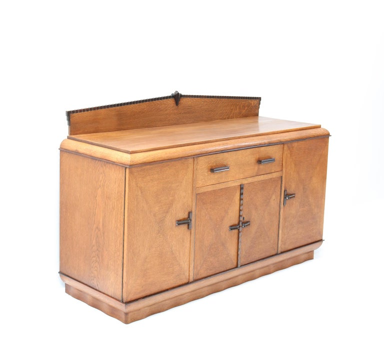 Stunning and rare Art Deco Amsterdam School credenza or sideboard. Design by Fa. Drilling Amsterdam. Striking Dutch design from the 1920s. Solid oak with original solid macassar ebony handles and lining. In very good condition with a beautiful