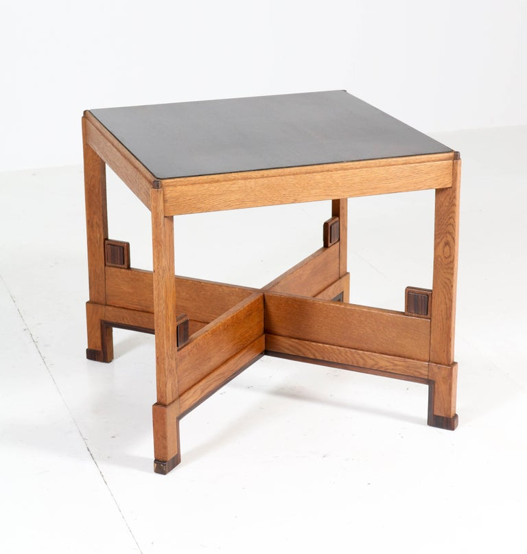 Wonderful and rare Art Deco Haagse School coffee table. Striking Dutch design from the 1920s. Solid oak base with ebony Macassar veneered top. In very good condition with minor wear consistent with age and use, preserving a beautiful patina.