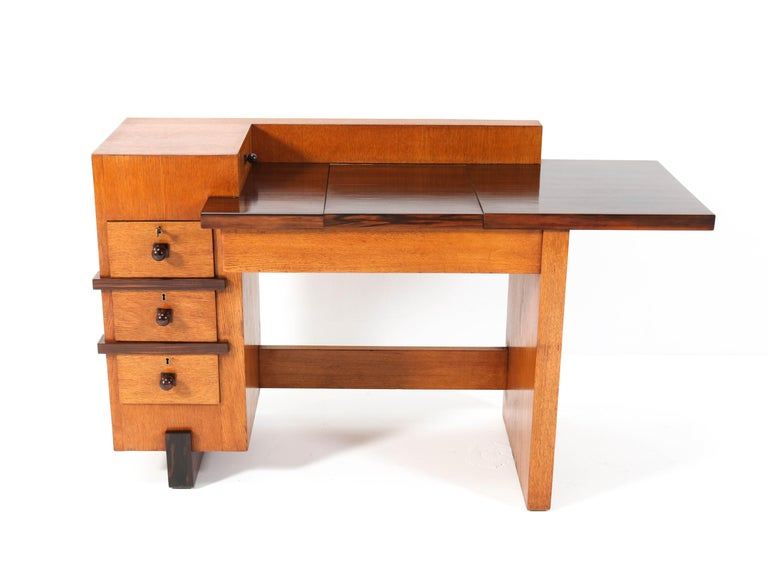Magnificent and ultra rare Art Deco Haagse School desk or writing table. Design by Hendrik  Wouda for H. Pander & Zonen. Striking Dutch design from the 1920s. Solid oak and oak veneer with original solid Macassar ebony knobs. The writing section is