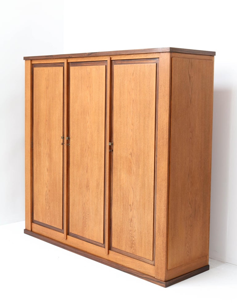 Magnificent and ultra rare Art Deco Haagse School armoire or wardrobe. Design by Hendrik Wouda for H. Pander & Zonen. Striking Dutch design from the 1920s. Solid oak and oak veneer with solid Macassar ebony and Macassar ebony veneer. Three