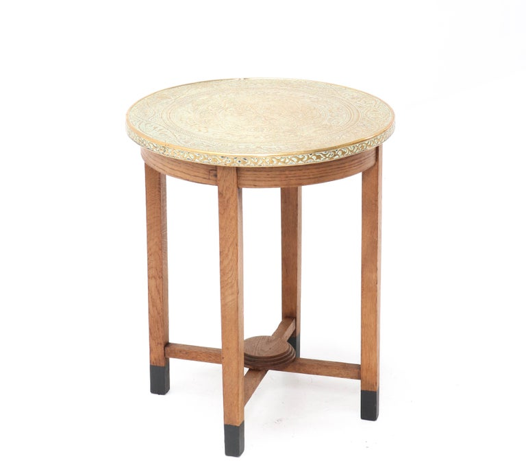 Wonderful Art Deco occasional table. Striking Dutch design from the 1920s. Solid oak frame with original etched brass top. In very good condition with minor wear consistent with age and use, preserving a beautiful patina.