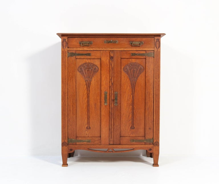 Wonderful and rare Arts & Crafts Art Nouveau cupboard.