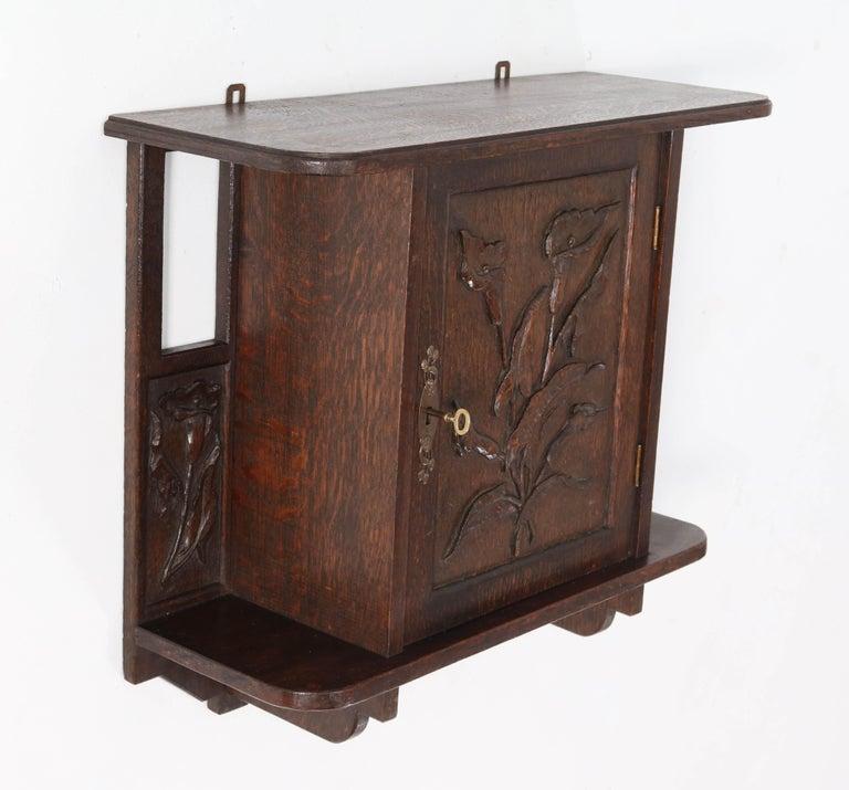 Dutch Oak Arts & Crafts Art Nouveau Wall Cabinet with Calla Lilies, 1900s For Sale
