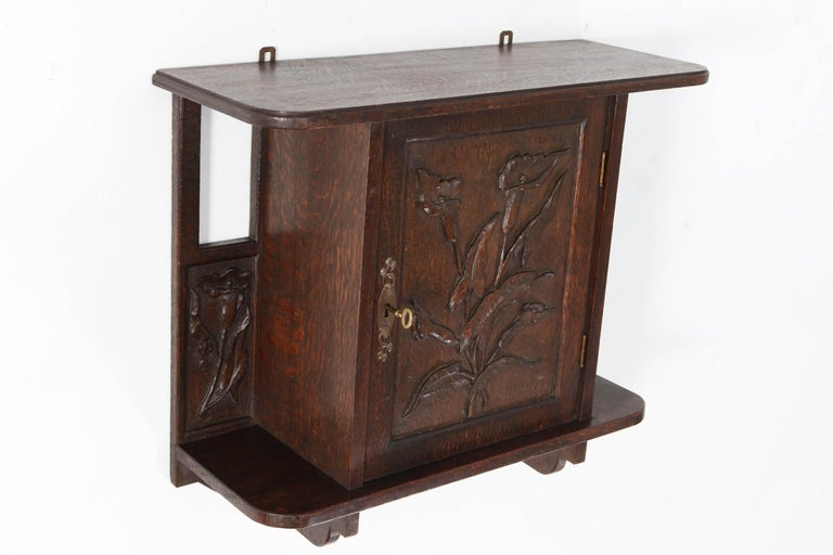 Early 20th Century Oak Arts & Crafts Art Nouveau Wall Cabinet with Calla Lilies, 1900s For Sale