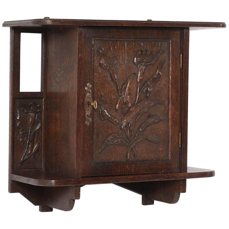 Oak Arts & Crafts Art Nouveau Wall Cabinet with Calla Lilies, 1900s For Sale