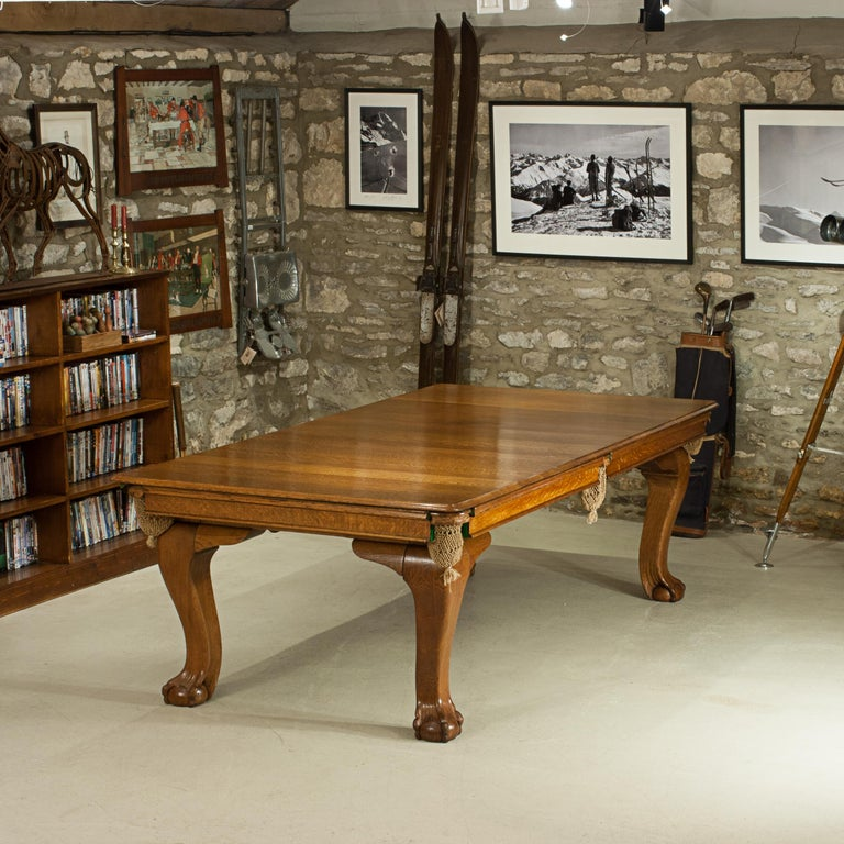 Riley dining snooker table. A fine quality 7 foot oak dining snooker, billiard, pool table by E. J. Riley Ltd., of Accrington. The dual height billiard dining table has cabriole legs with ball and claw feet and a five leaf dinning top. The leaves