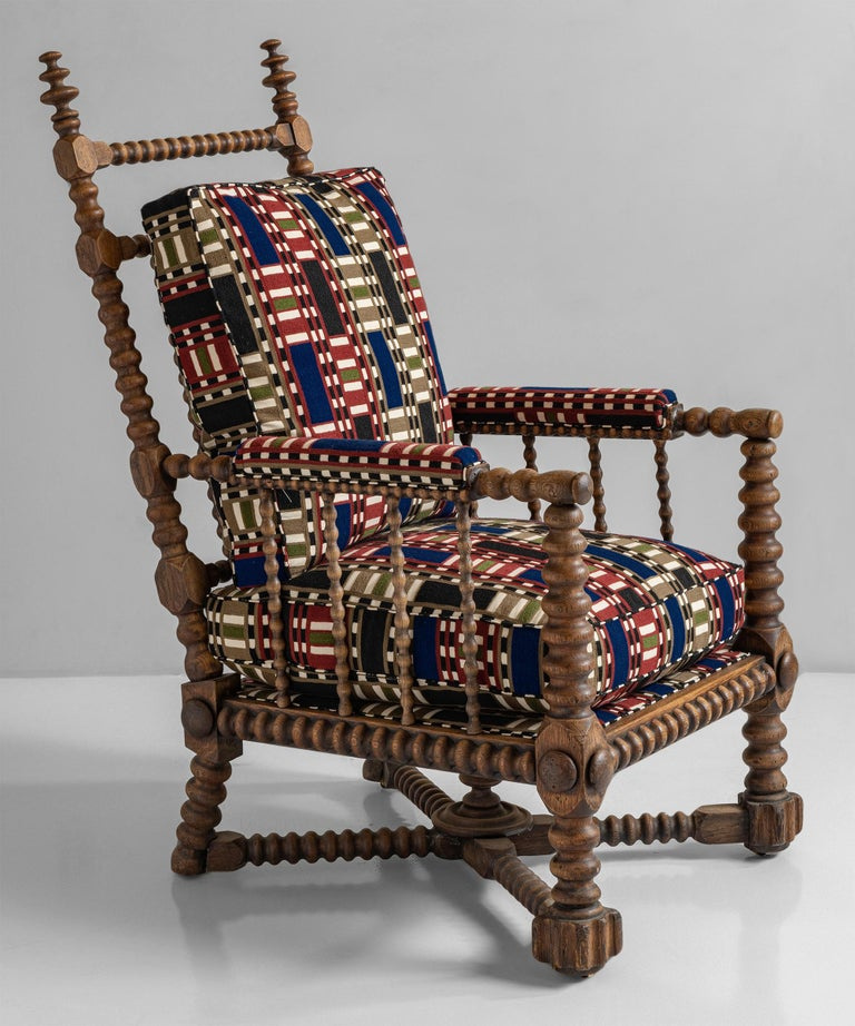 Oak Bobbin armchair in wool-linen chain stitch embroidery from Pierre Frey England circa 1890 Bobbin turned armchair with original castors. Measure: 26