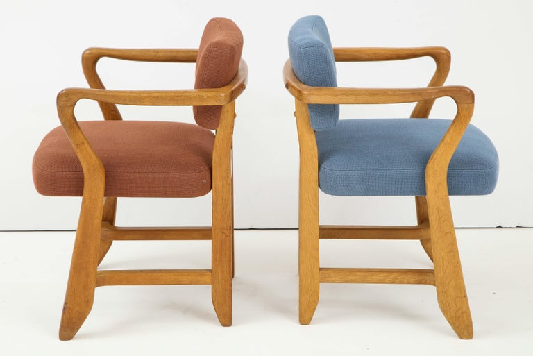 These sculptural armchairs were designed by Guillerme and Chambron in France in the 1950s. The duo is known for their high quality solid oak furniture. These chairs are called Bridge chairs due to the horizontal line that forms the armrests. The