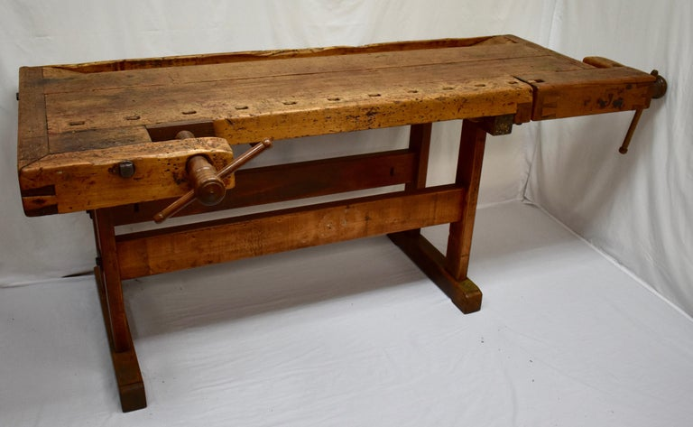 """This massive oak Joiner's workbench is built as solid as a rock and is beautifully gnarled after decades of purposeful use. The trestle-style base is made entirely of oak. The uprights are over 2""""x4"""", hand-cut and nicely rounded on the corners,"""
