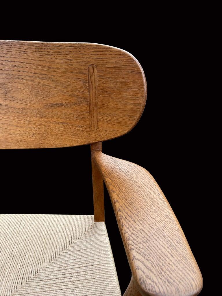 Scandinavian Modern Oak CH22 Lounge Chair by Hans J. Wegner for Carl Hansen For Sale