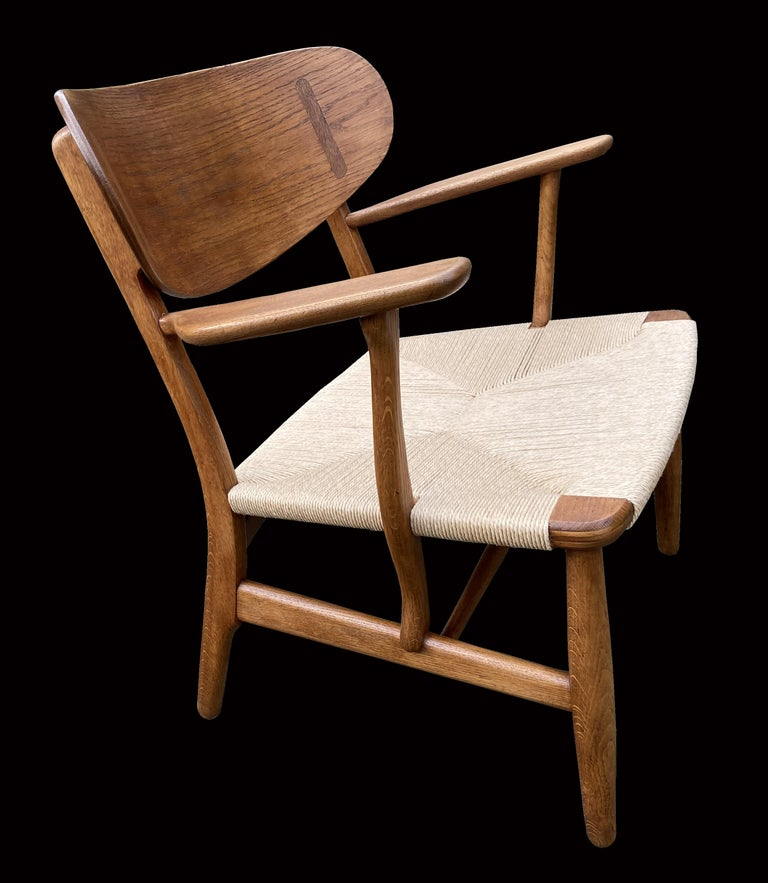 Scandinavian Modern Oak CH22 Lounge Chair by Hans J. Wegner for Carl Hansen For Sale