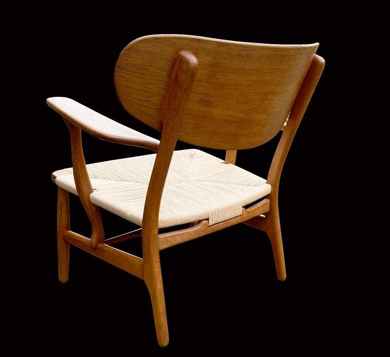 Danish Oak CH22 Lounge Chair by Hans J. Wegner for Carl Hansen For Sale