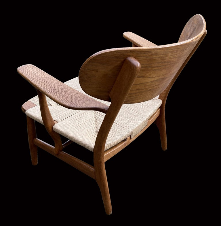 Danish Oak CH22 Lounge Chair by Hans J. Wegner for Carl Hansen For Sale