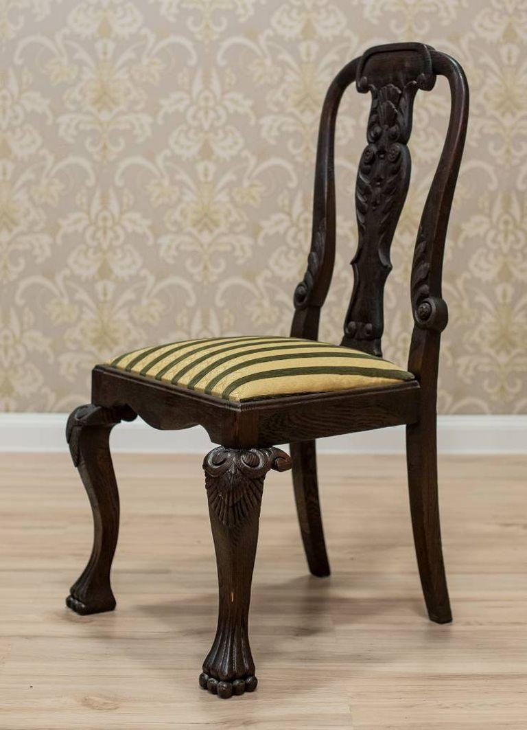 A chair in the Anglo-Dutch type, with a wooden backrest and an upholstered seat.
