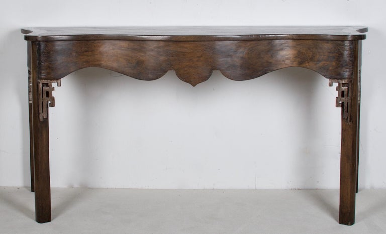 A lovely oak console by a famous interior design showroom. The console has some oriental design aspects as well as a serpentine scalloped front. Very beautiful handcrafted piece with a modern finish.