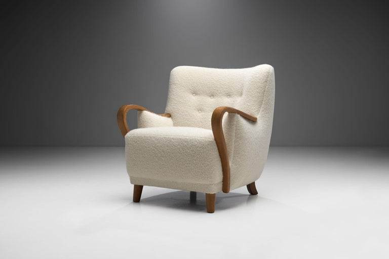 This unique easy chair is a great representation of the quality and craftsmanship of Danish master cabinetmakers and the immediately recognizable characteristics of Scandinavian design. Particularly visible here is Danish designers' predilection for